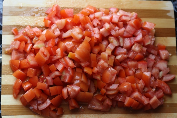 Chop tomatoes for shakshouka
