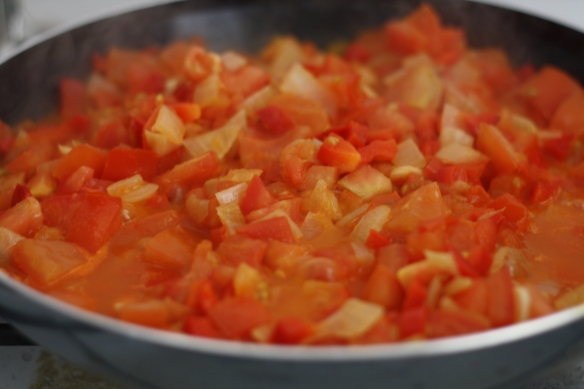 Sauteing tomatoes for shakshouka