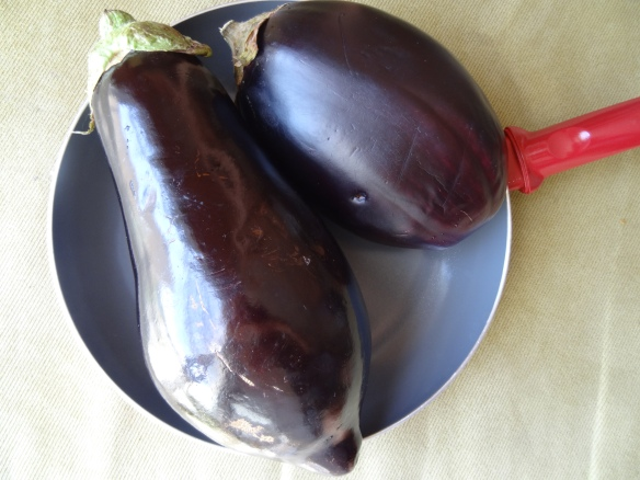 Place eggplants in pan