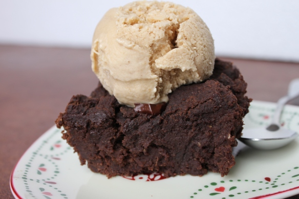 Big, gooey, chunky brownie piece with ice-cream